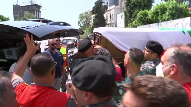 coffin of firefighter killed in explosion taken to fire station; lebanon: beirut: ext coffin of firefighter killed in the port explosion carried... - firefighter stock videos & royalty-free footage