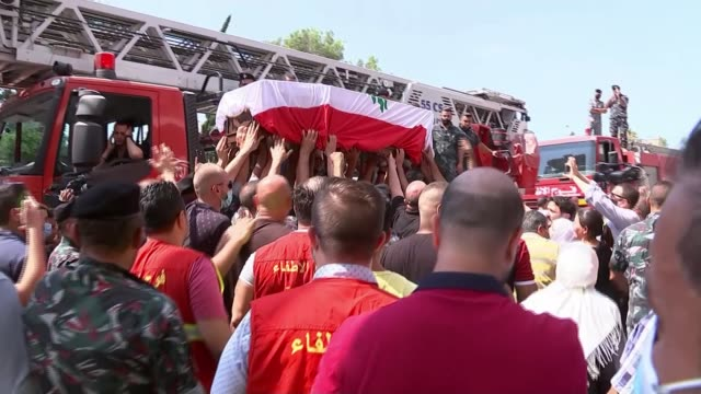 lives lost in explosion remembered in a minutes silence; lebanon: beirut: ext coffin bearing rami kaaki carried along by pallbearers rami's mother in... - mourning stock videos & royalty-free footage