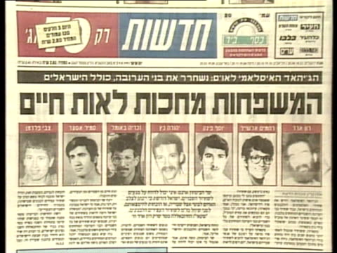 beirut hostages israel jerusalem cms newspaper headline on john mccarthy release cms another paper with pictures of hostages held cms ditto pan lr... - 人質点の映像素材/bロール