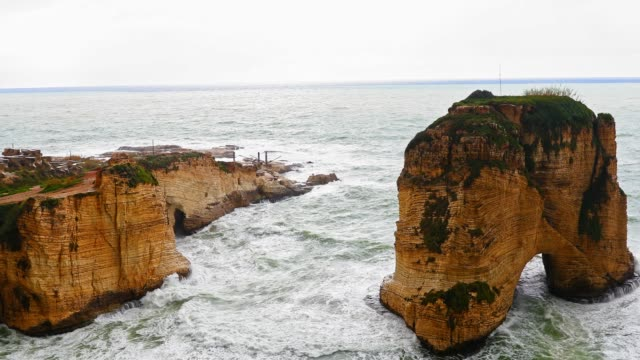 beirut's natural landmark - the pigeons' rock / the rock of raouché - beirut stock videos & royalty-free footage