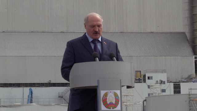 Belarusian President Alexander Lukashenko speaks during a statement in front of the new protective shelter over the remains of the nuclear reactor...