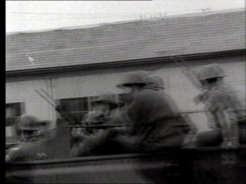 Belfast B/W Pix of British soldiers in truck going into Belfast parading on street barbed wire fence