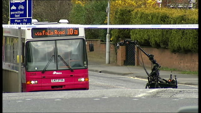 belfast bus with suspect bomb on board and lorry on fire northern remote controlled robot device along towards empty belfast city bus suspected of... - remote controlled stock videos and b-roll footage
