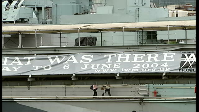 day exhibition; itn england: london: ext gv hms belfast gun on ship traversing banner advertising d-day exhibition hms belfast: cms nick hewitt... - exhibition stock videos & royalty-free footage