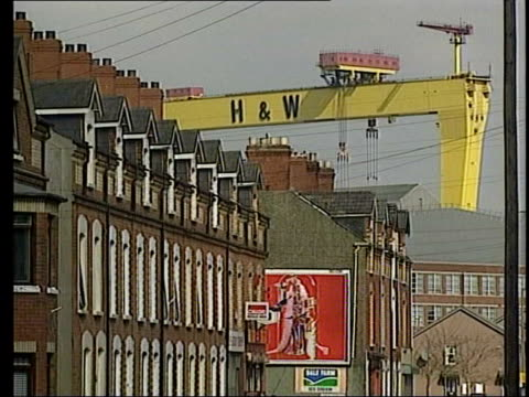 belfast: ext lms cranes at harland & wolff shipyard k la lms crane gangry seen beyond houses air view shipyard bv welders at work on hull - shipyard stock videos & royalty-free footage