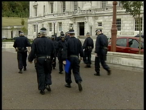 Belfast EXT Seq Armed police away into Stormont to raid Sinn Fein's offices Police along inside building