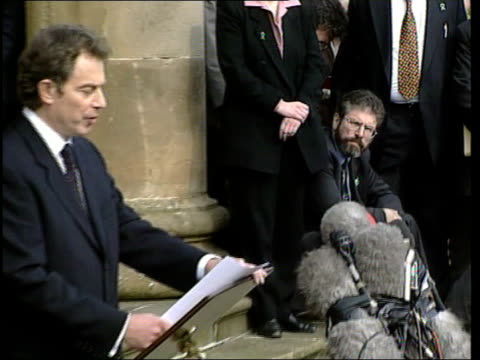 Belfast Hillsborough Castle i/c Tony Blair and Bertie Ahern out of building and up to microphones MS Gerry Adams MP sitting on steps looking towards...
