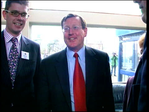 belfast: int david trimble mp chatting and laughing with others ext cms trimble along and into car people standing at railings holding union jack... - フリーズフレーム点の映像素材/bロール