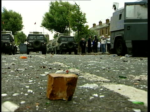 Belfast Limestone EXT RUC landrovers PAN stranded RUC vehicle which was attacked during riots with smashed glass on ground LA GV Large rock on ground...