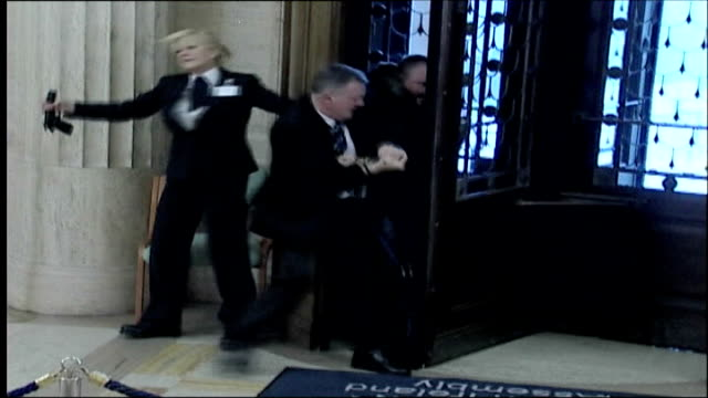 michael stone in court following storming of stormont building tx stormont int michael stone being stopped by security guards when trying to enter... - stormont stock videos and b-roll footage