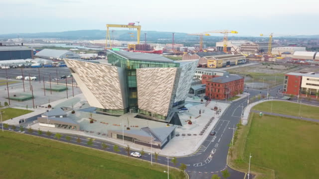belfast northern ireland titanic quarter drone 4k video flight - titanic belfast stock videos & royalty-free footage