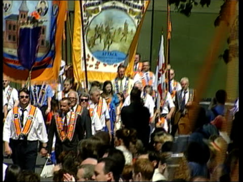 belfast orange march northern ireland belfast ext tgv orange order marchers approaching barrier erected to prevent them marching down the lower... - disposable stock videos and b-roll footage