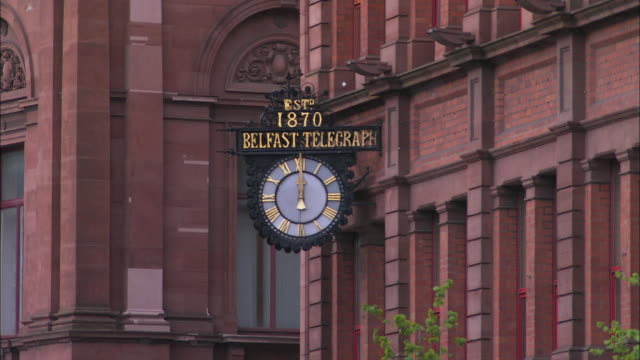 belfast telegraph clock at midday, northern ireland - midday stock videos & royalty-free footage