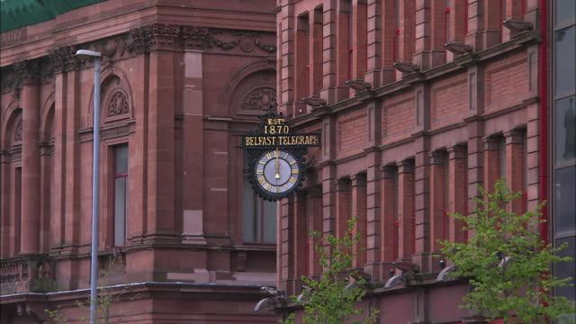 belfast telegrpah clock, zoom out to show busy street and buildings, northern ireland - belfast stock videos & royalty-free footage