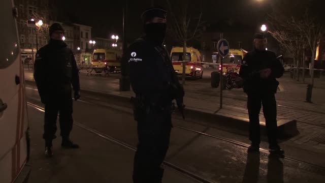 Belgian and French police launch a vast manhunt for more possible suspects after a Kalashnikov wielding assailant was killed and four officers were...