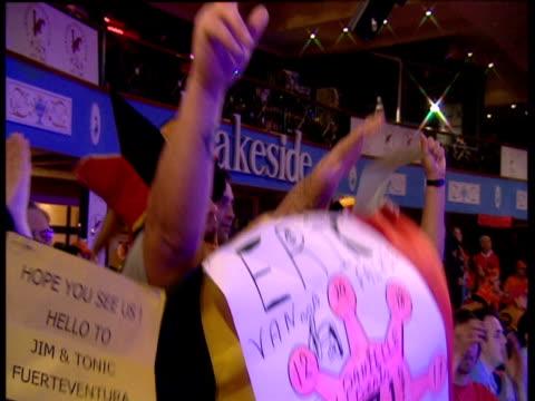 Belgian darts supporters wearing novelty jester hats go wild in celebration 2003 Embassy World Darts Championships Lakeside Frimley Green