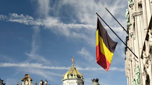 Belgian flag fluttering at the Grand Place in Brussels