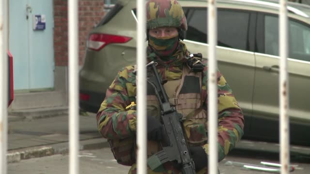 Belgian investigators are hunting a man seen fleeing Brussels airport after a suicide bombing as the country holds three days of mourning for around...