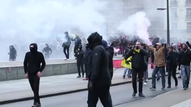 belgian police use teargas antiriot vehicles to disperse farright and antimigration protesters near the eu buildings in brussels on december 16 2018... - emigration and immigration stock videos & royalty-free footage