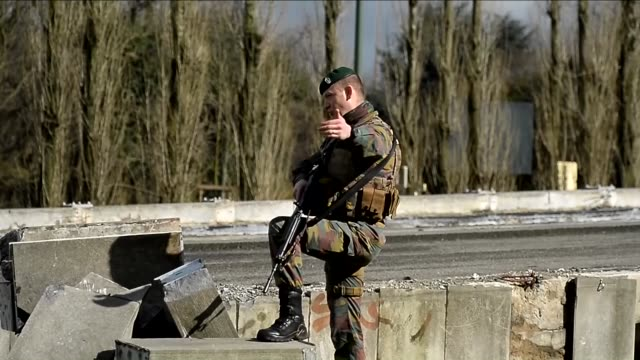 belgian security forces take security measures during the counter terrorism operation following multiple terror attacks, at schaarbeek district in... - terrorism stock videos & royalty-free footage