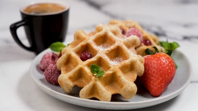 belgian waffles with confectionary sugar - crunchy stock videos & royalty-free footage