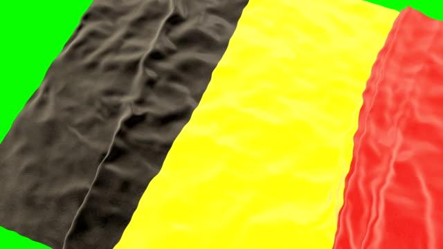 Belgische wapperende vlag. Groen scherm. Close-up