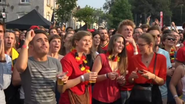 belgians watch their national team take on brazil in the world cup quarter finals - international team soccer stock videos & royalty-free footage