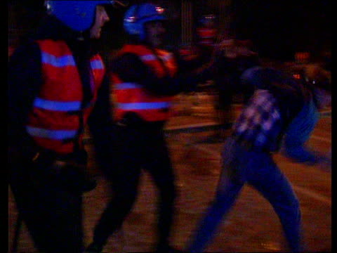 belgium bruges night/28295 bv riot police using batons against bruges fans track round ms side riot police hitting out pan lr as one supporter... - hooligan stock videos & royalty-free footage