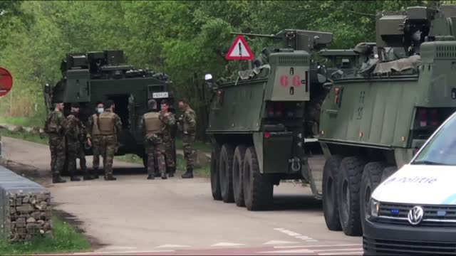 belgium police have launched an operation to nab a heavily armed soldier with far-right tendencies who disappeared after threatening a virologist... - military stock videos & royalty-free footage