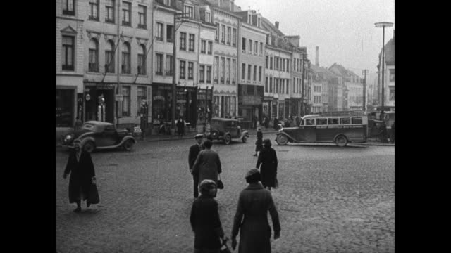 belgium streets belgians cars buildings ws nazi german soldiers standing outside of homes ws car at border checkpoint guard checking sign 'halt' - 1935 stock videos and b-roll footage