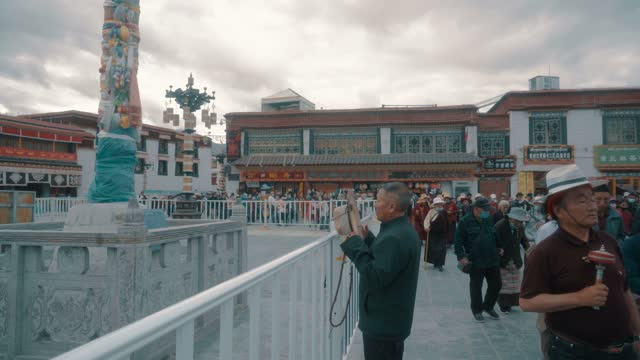 believers pray in front of  jokhang temple,tibet,china. - traditionally tibetan stock videos & royalty-free footage