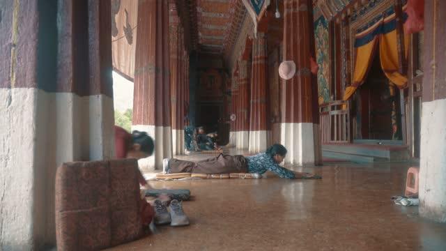 believers pray in sera temple,lsahatibet,china. - traditionally tibetan stock videos & royalty-free footage