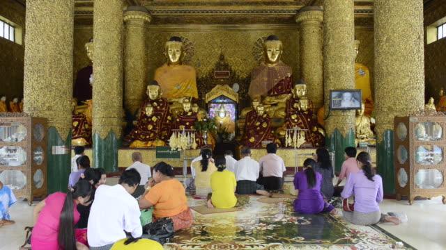 ms believers praying in shwedagon pagoda / yangon, yangon division, myanmar - male likeness stock videos & royalty-free footage