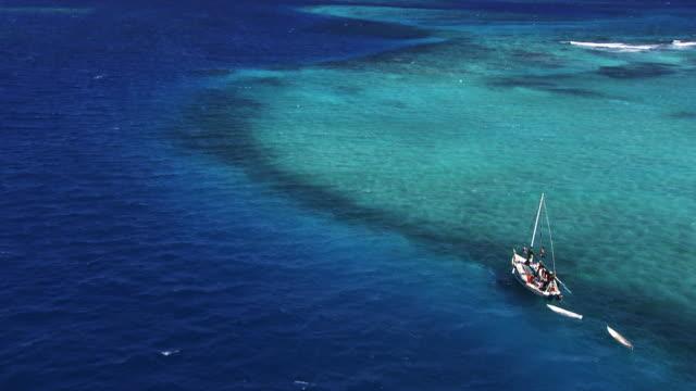 Belize: Anchored sailboat