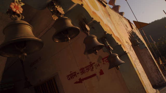 bell at temple - india - bell stock videos & royalty-free footage