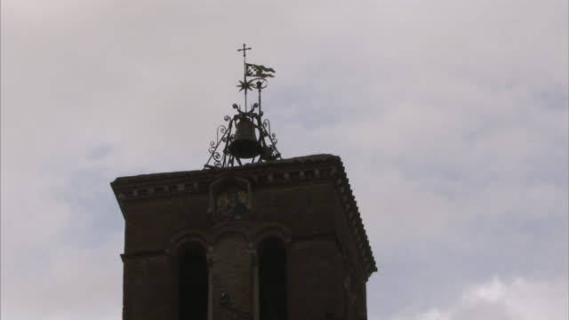 A bell crowns the tower of the Church of Santa Maria in Trastevere in Rome, Italy.