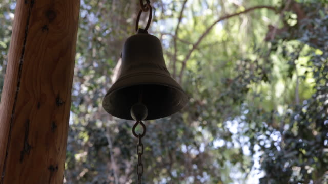 bell hanging down the roof in a backyard on a property in calera de tango chile calera de tango shows the great jesuit mission art like the workshops... - jesuit stock videos and b-roll footage