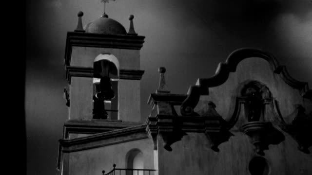 a bell hangs motionless in the bell tower of a spanish mission. - 1945 stock videos & royalty-free footage