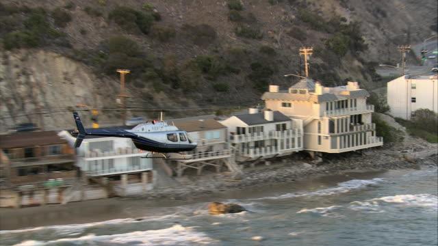 air to air, bell jet ranger flying along coast, malibu beach, california, usa - malibu stock videos & royalty-free footage