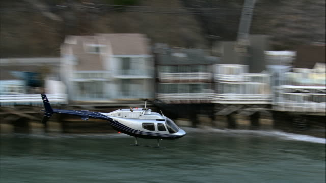 air to air, bell jet ranger flying along coast, malibu beach, california, usa - air to air shot stock videos and b-roll footage