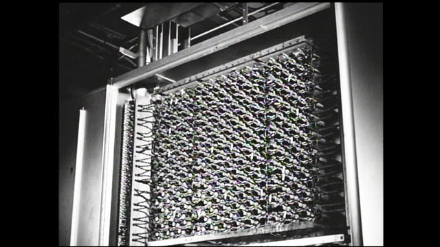 bell logo on the glass door; woman lecturing class full of women on the diagram on the chalkboard; telephones passing by on the conveyor belt; metal... - 1940 1949 stock videos & royalty-free footage