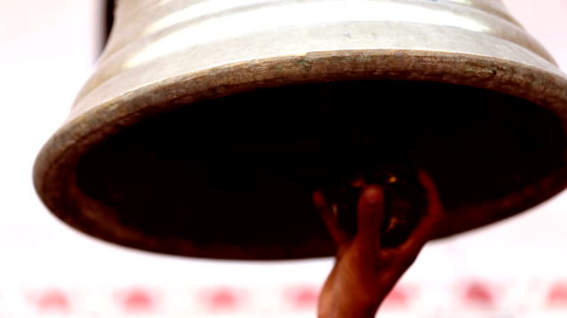 bell ringing at hindu temple - bell stock videos & royalty-free footage