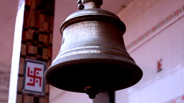 bell ringing at hindu temple - priest stock videos & royalty-free footage
