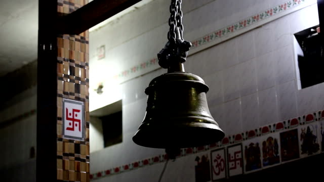 bell ringing at hindu temple - bell stock videos and b-roll footage