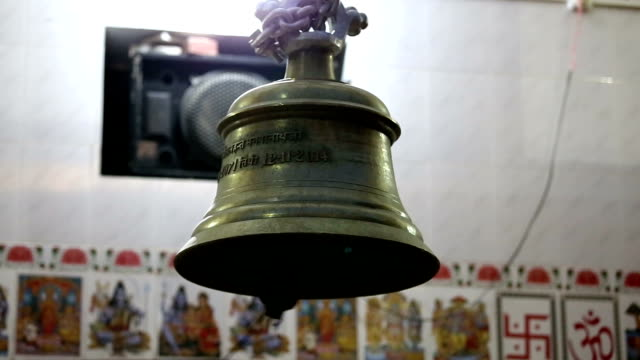 bell ringing at temple during prayer - bell stock videos & royalty-free footage