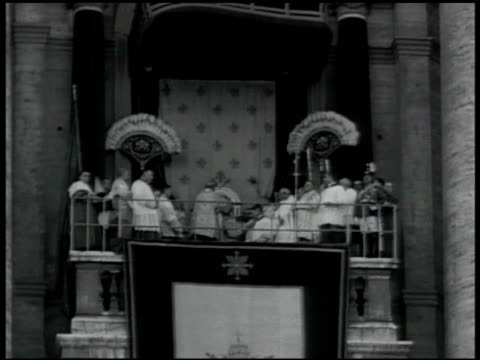 coronation bell ringing below clock on vatican pope pius xii on loggia w/ others male placing papal tiara huge crowd in st peter's square pope pius... - priest stock videos and b-roll footage