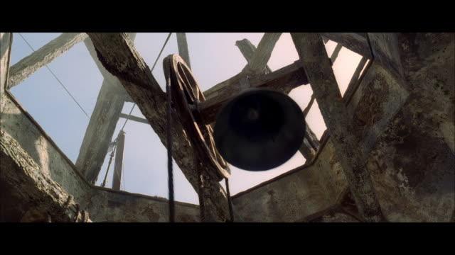stockvideo's en b-roll-footage met la bell ringing in a stone tower - aanbellen
