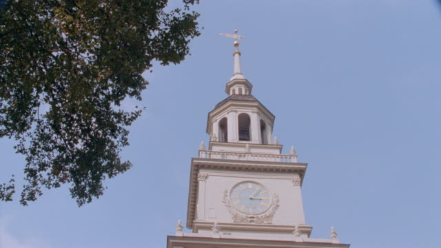 a bell tower adorns the top of independence hall. - independence hall stock videos & royalty-free footage