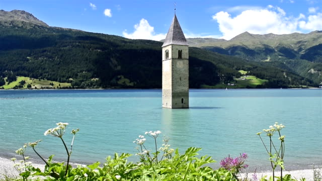 Bell tower in the Lake Reschen - Reschensee - Lago di Resia, Val Venosta - Vischgau, South Tyrol, Italy
