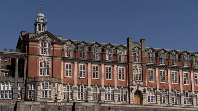 a bell tower tops a building on the campus of britannia royal naval college in dartmouth. available in hd. - dartmouth england stock videos & royalty-free footage